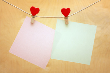 note hanging on the clothesline with hearts