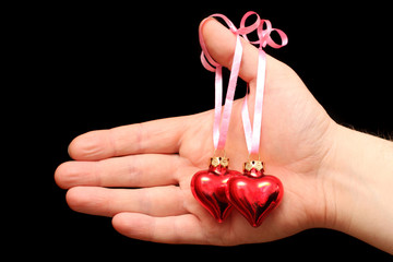 man's hand gives hearts. Valentine's Day