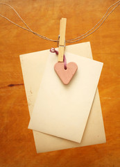 vintage photos and red heart hanging on the clothesline