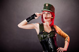 Young woman dressed in military style latex