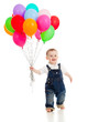 Smiling baby boy  with bunch of colorful ballons in his hand. Is