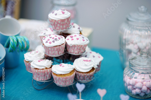 Delicious colorful wedding cupcakes with hearts icing
