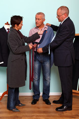 Husband and wife bespoke suit fitting