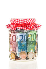 Financial reserves. Money conserved in a glass jar.