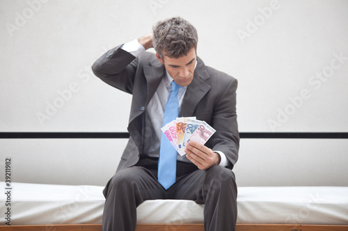Businessman having money problems