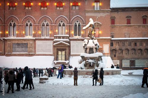 Leinwanddruck Bild Neptune square covered by snow. Bologna, Italy.