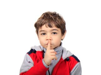 bambino con il dito alla bocca