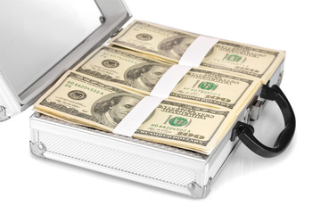 A lot of one hundred dollar bills in a case isolated on white