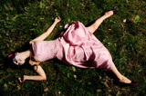 girl lie on the grass like a corpse