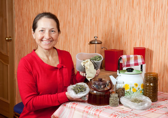 Mature woman brews herbs