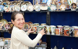 tourist  chooses souvenir cup in egyptian shop