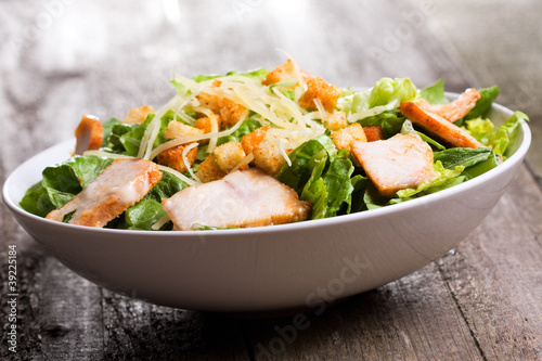 Fotobehang Salade Caesar salad with chicken and greens