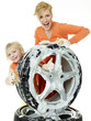 Young woman and cute girl cleaning a wheel