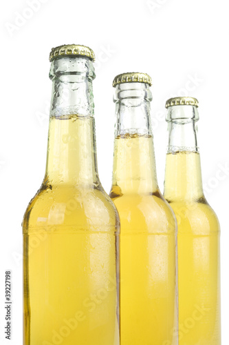 beer bottles with water drops, close up, isolated