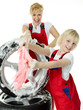 Blonde sisters in overall faving fun while cleaning a wheel