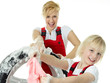 Blonde sisters wearing overalls washing a wheel