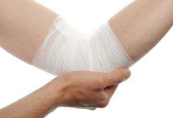 medical bandage on injury elbow