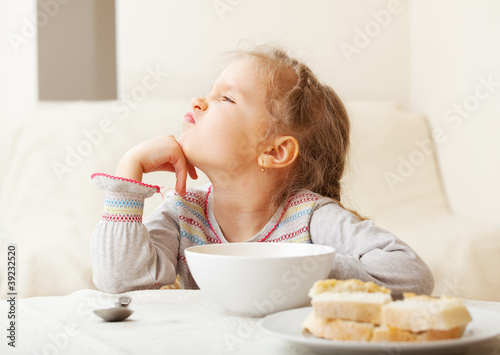 Girl looks with disgust for food