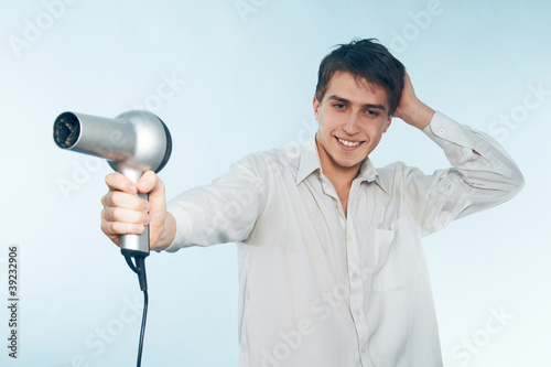 man with a hair dryer
