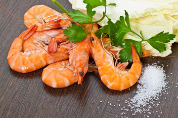 Prawns with a sprig of parsley and salad close up.