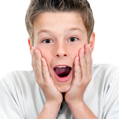 Close up of boy with surprising face expression.
