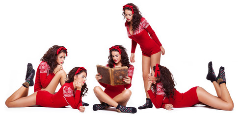 Young brunette reading a book of her clones on white background