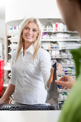 Female Pharmacist With A Customer In Pharmacy