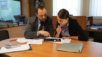 Young man and woman working with tablet portrait