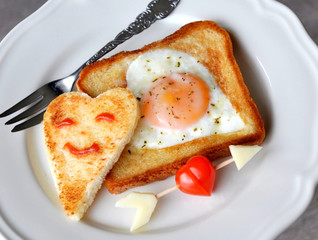 Heart-shaped fried egg and toast
