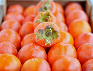 Persimmons in a box