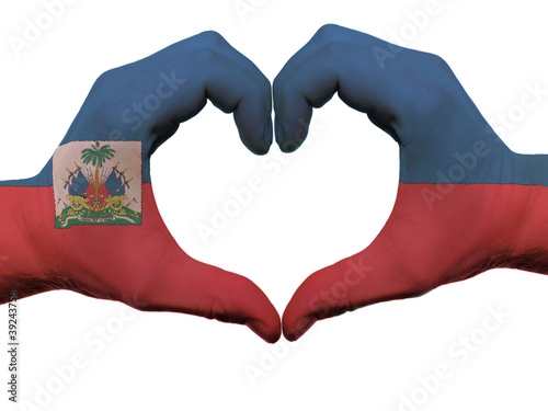 Heart and love gesture in haiti flag colors by hands isolated on