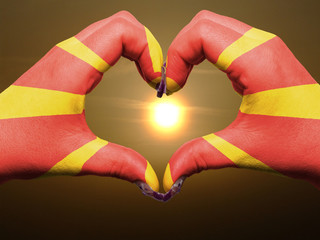 Heart and love gesture by hands colored in macedonia flag during