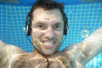 man underwater listen music with head-phones