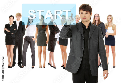 Businessman pushing START on a touch screen interface.
