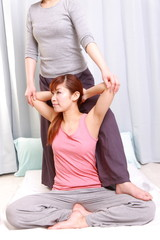 woman getting a thai massage