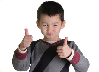 child shows his fingers as good