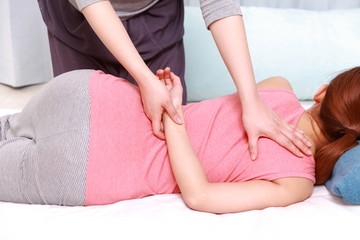 woman getting chiropractic