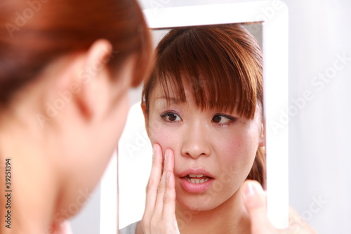 young woman worries about dry rough skin
