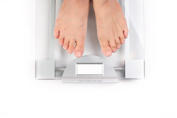 Woman takes her weight on white