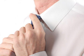 closeup businessman straightens his tie