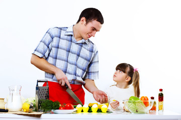 family with a daughter cooking together at home