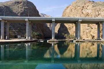Modern bridge over river in Oman