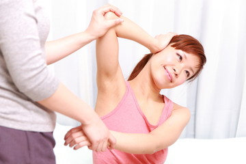 young woman getting a thai massage