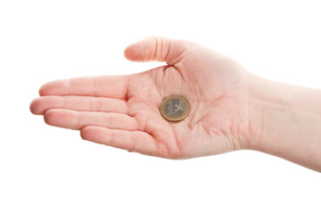 Female hand holding an euro coin