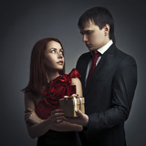 Man giving gift to his beloved. Romantic image poster