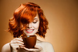 Fototapety Stylish woman with an aromatic coffee in hands