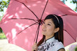 Pretty chinese woman holding umbrella