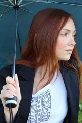 Pretty woman with an umbrella