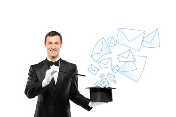 Smiling magician and mails coming out of a top hat