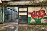 Wooden door inside an old derelict warehouse